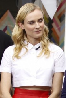 Look of the Day: Diane Kruger Effortlessly Combines a Cropped Carven Blouse and Red Leather Vanessa Bruno Skirt