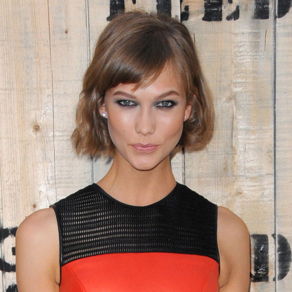 Karlie Kloss with smokey eye makeup and coral blush