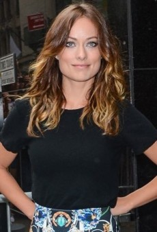 Olivia Wilde Tops Off Her Vivid Clover Canyon Skirt with a Black Crippen Alex Tee