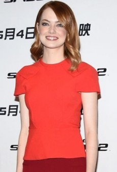 Emma Stone Revs Up the Red in Roland Mouret