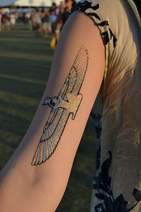 metallic flash tattoo on arm at Coachella
