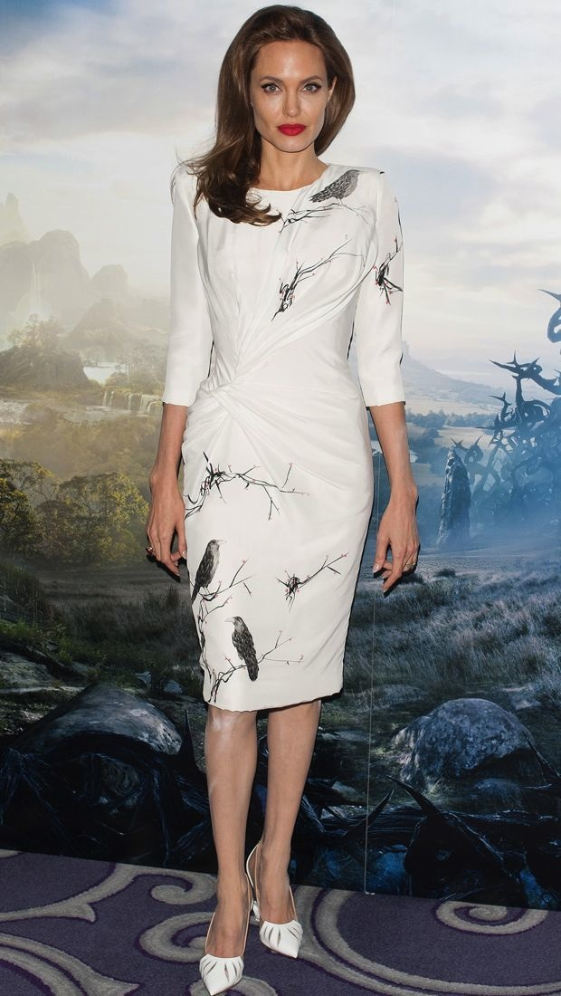 Angelina Jolie wears a raven print Atelier Versace dress to the Maleficent photocall in London