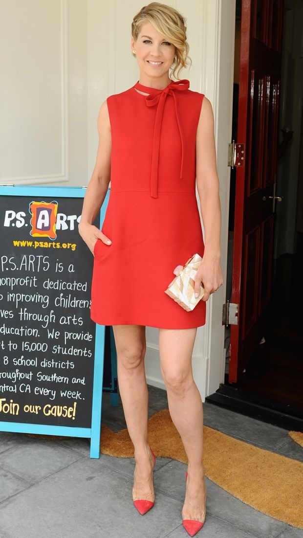 Jenna Elfman wears a red shift dress complete with neck tie