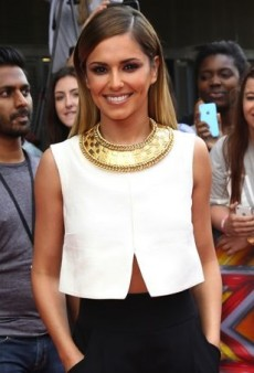 Cheryl Cole Polishes Off Her White Jil Sander Top with a Gold Balmain Necklace