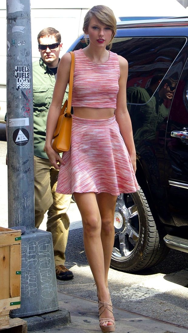 Taylor Swift checks out the East Village in an Aqua crop top and matching skirt