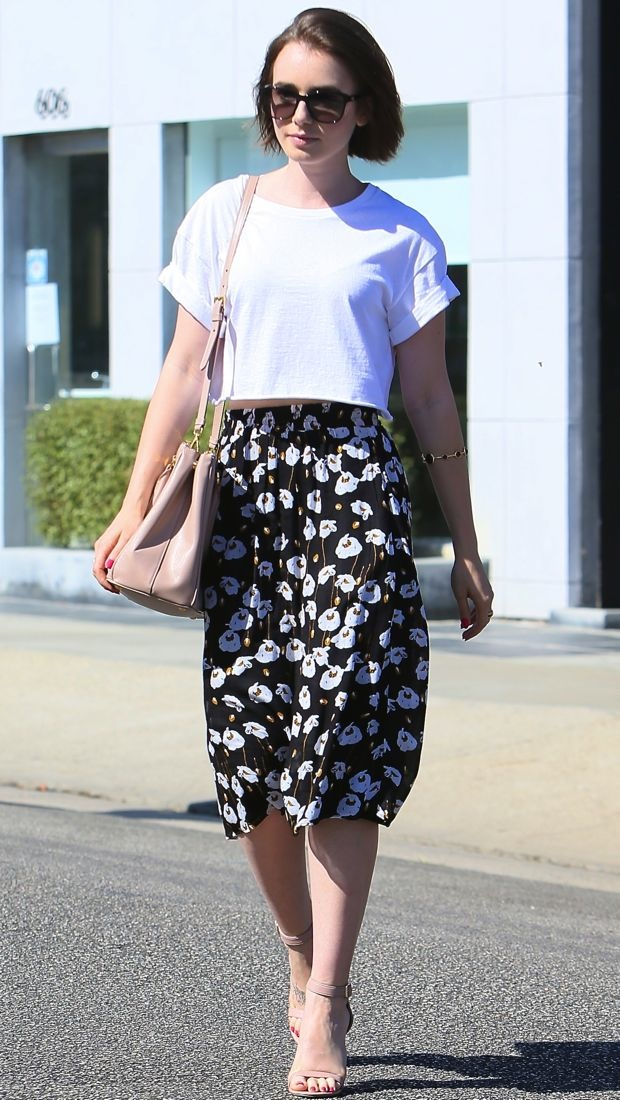 Lily Collins visits the salon in a cropped white tee and a black Ella Moss skirt