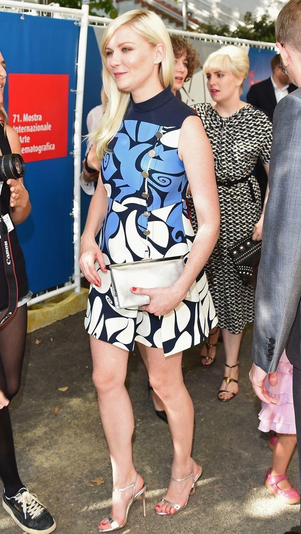 Kirsten Dunst wears a patterned Miu Miu Resort 2015 dress in Venice