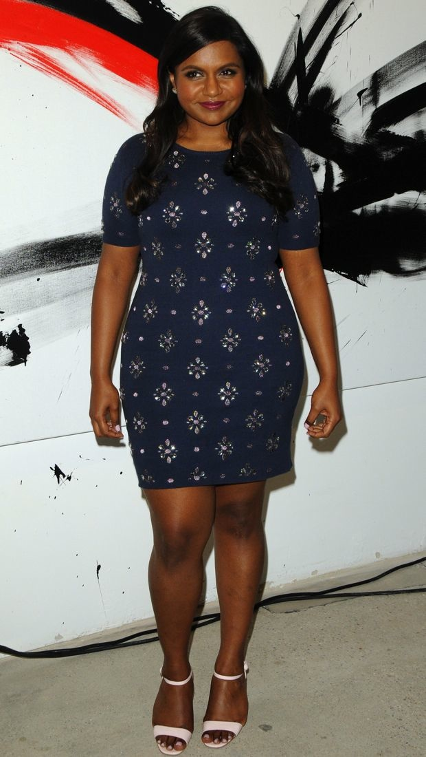 Mindy sparkles at a speaker series in an Opening Ceremony dress