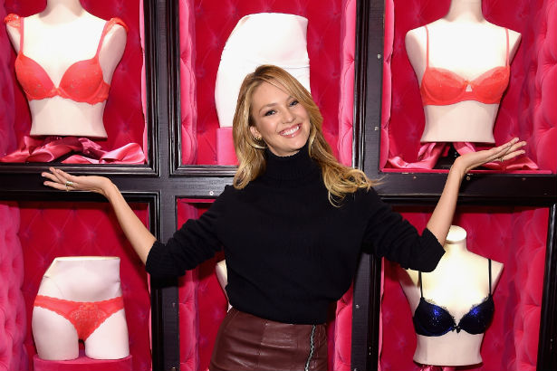 Candice Swanepoel posing inside one of the Victoria's Secret flagship stores
