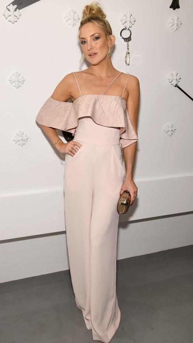 Kate Hudson wears a ruffled Paper London jumpsuit
