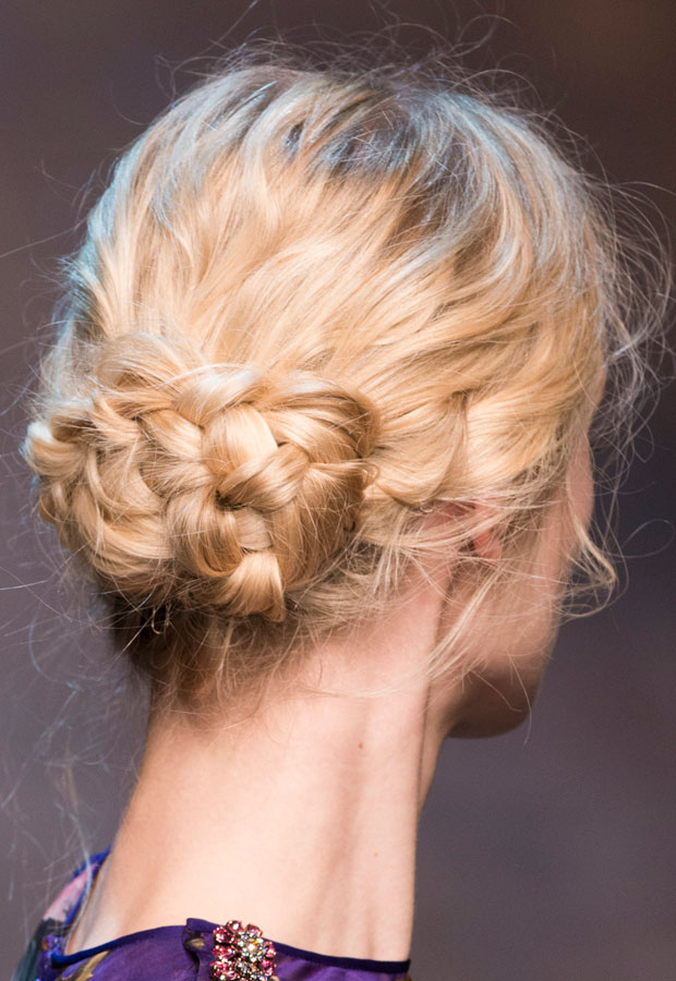 A messy braided bun up-do