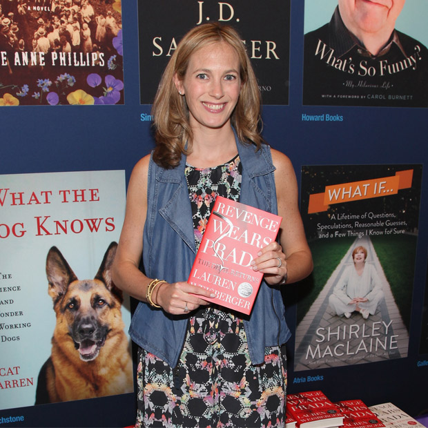 Lauren Weisberger posing with her book