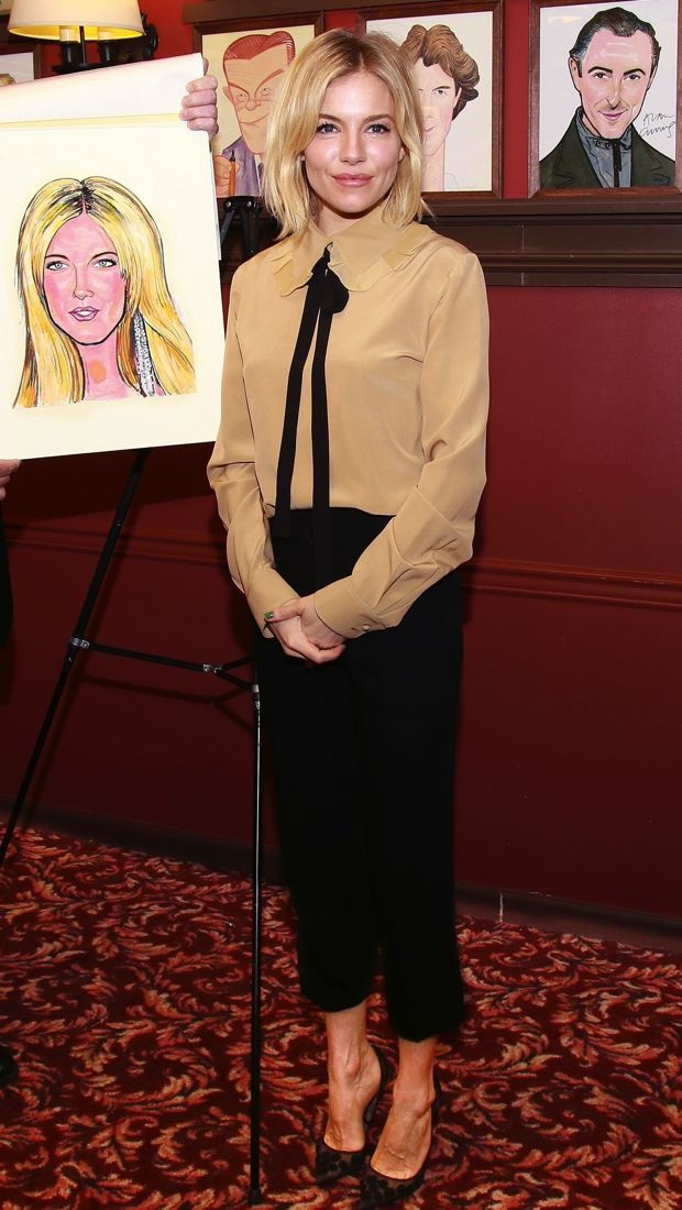 Sienna Miller watches her caricature portrait unveiling at Sardi's in a chic, menswear-inspired ensemble