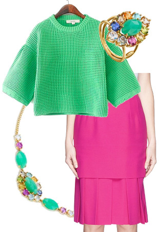 A TOUS gemstone necklace and ring, a green sweater and a pink pleated skirt.