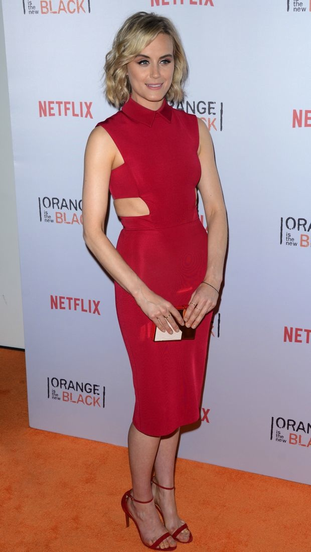 Taylor Schilling wears a red hot cut-out dress to the OrangeCon Fan Event