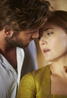 Watch: Liam Hemsworth and Kate Winslet Get Up Close and Personal in Debut Trailer for 'The Dressmaker'