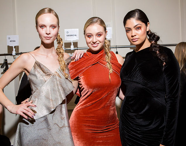 Kristy Kaurova, Iskra Lawrence and Jocelyn Corona pose backstage at Christian Siriano Fall 2017