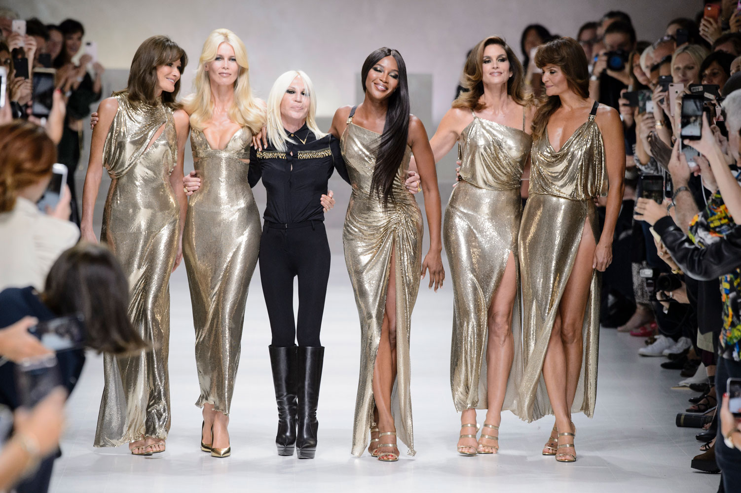 Carla Bruni, Claudia Schiffer, Naomi Campbell, Cindy Crawford and Helena Christensen join Donatella Versace for the Versace finale.