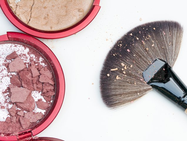 broken powder makeup and brush