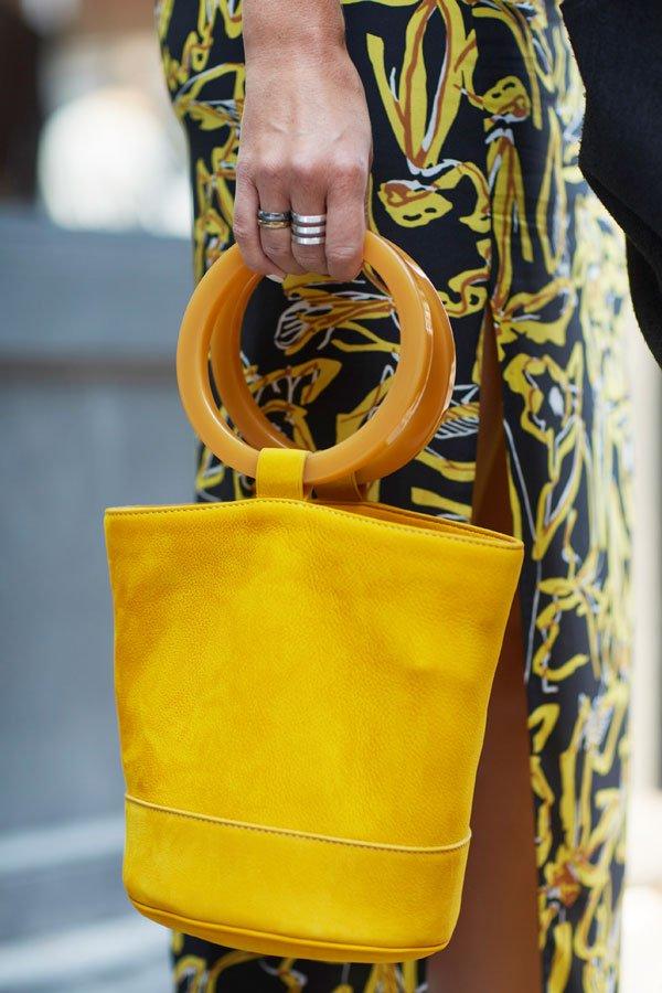 yellow top handle bag