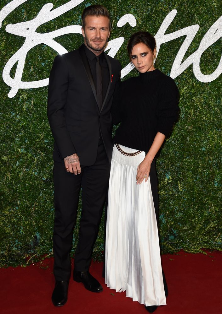 David Beckham in Christian Dior and Victoria Beckham in Victoria Beckham