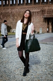 A white blazer teamed with a little black dress