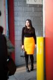 A brilliant orange skirt outside Karen Walker
