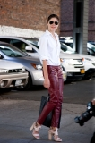 Emily Weiss of Into the Gloss wearing an on trend leather pant for fall