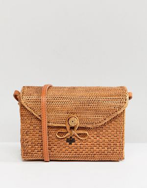 Rock N Rose  Raffia and Straw Basket Bags Are the Surprising City Essential for Spring 2018 rock n rose farah woven basket bag