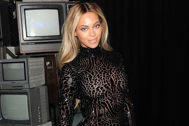 Beyonce Knowles in a black sheer dress