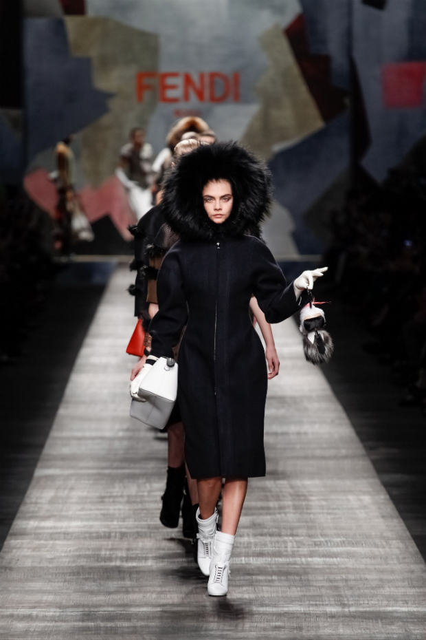 Cara Delevigne walking for FENDI with a karl lagerfeld doll with camera inside