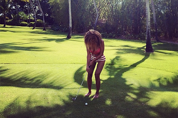 Beyonce golfs in this instagram photo where she has a large thigh gap