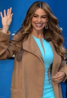 Sofia Vergara Tops Off Her Pastel Michael Kors Dress with a Rich Camel Coat