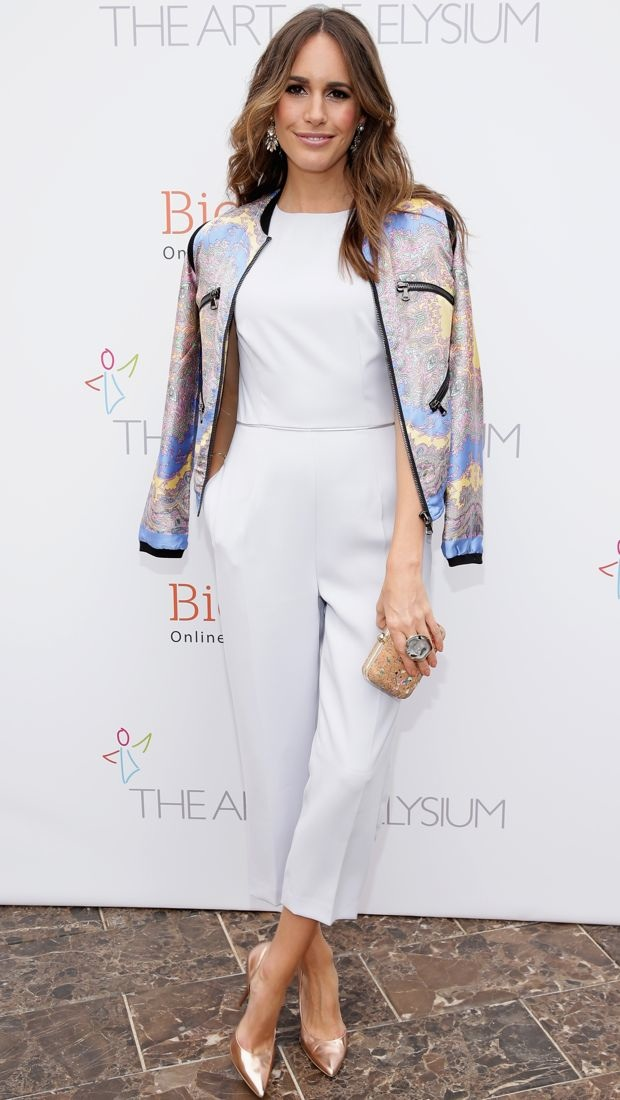 Louise Roe covers up her white Reiss jumpsuit with a paisley jacket at Cannes