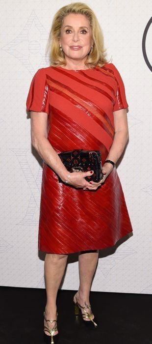 Catherine Deneuve in a red Louis Vuitton dress