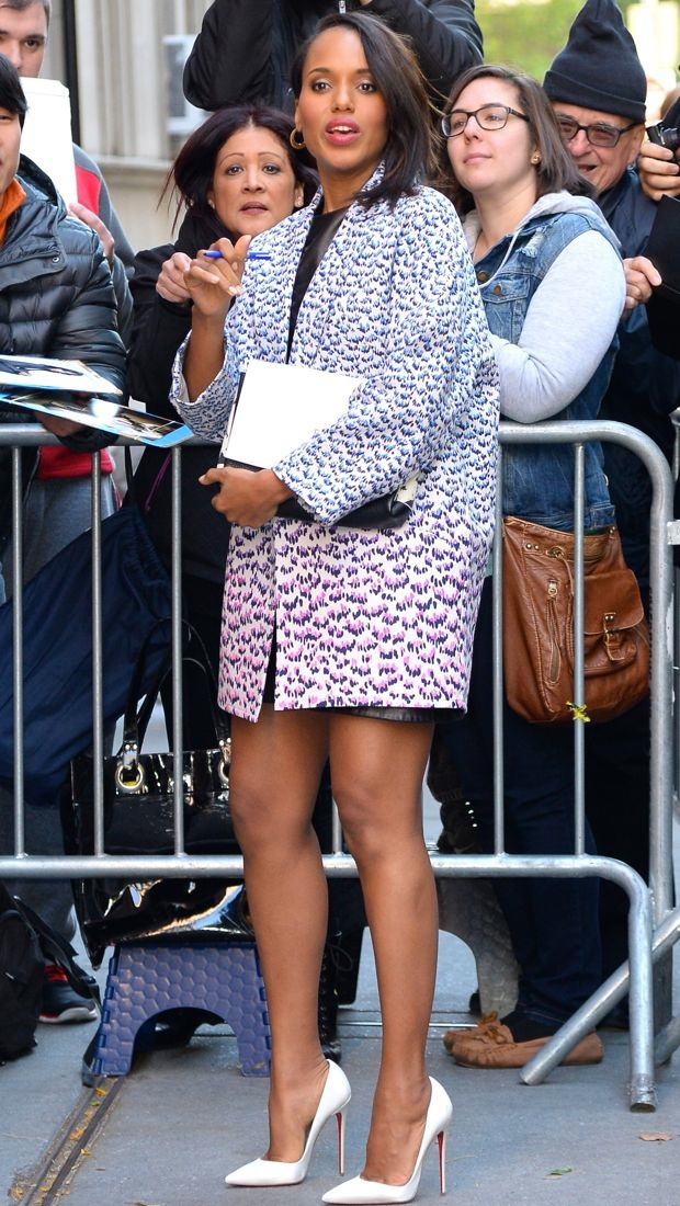 Kerry Washington wears a leopard coat over a black leather Alexander Wang dress