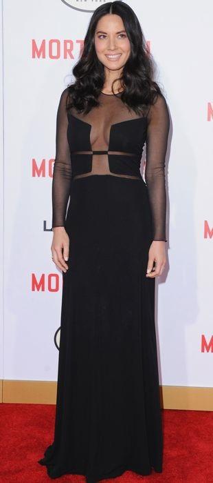 Olivia Munn wears a black Ralph Rucci dress
