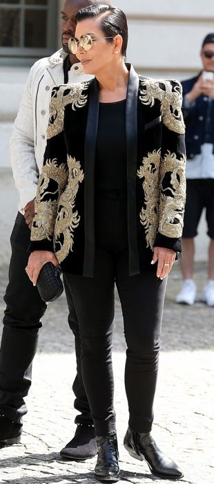 Kris Jenner in a Balmain dragon blazer at the Balmain Spring 2016 menswear show