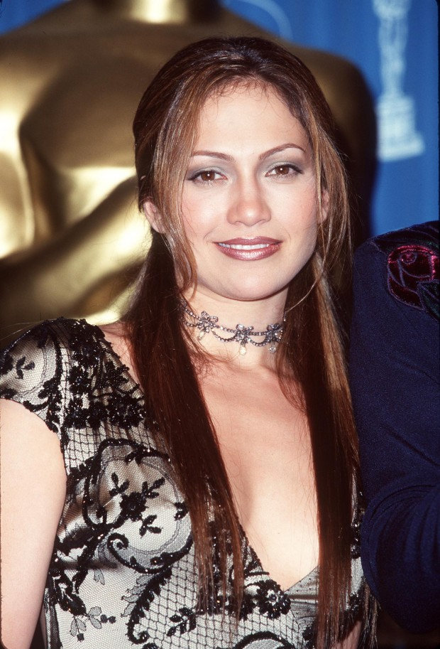 Jennifer Lopez, arbiter of 90s fashion, wears a choker at the 70th Annual Academy Awards.