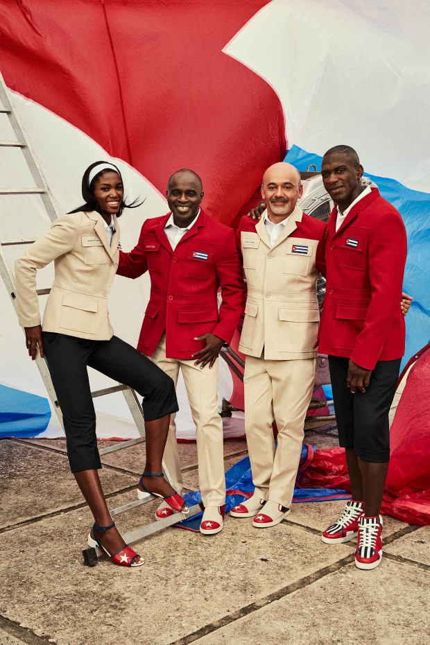 Members of the Cuban national team pose with Henri Tai and Christian Louboutin in the official nonperformance outfit for the 2016 Olympic Games.