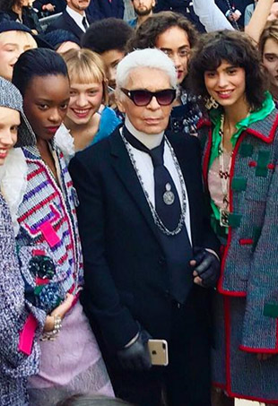 Karl Lagerfeld poses with models after the Chanel Spring 2017 presentation at the Grand Palais.