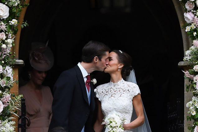 Pippa Middleton kisses her new husband James Matthews.