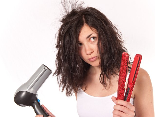 woman styling her hair in the morning